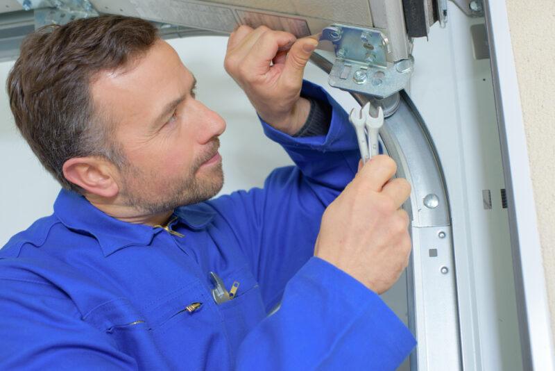Technician doing simple garage door fixes