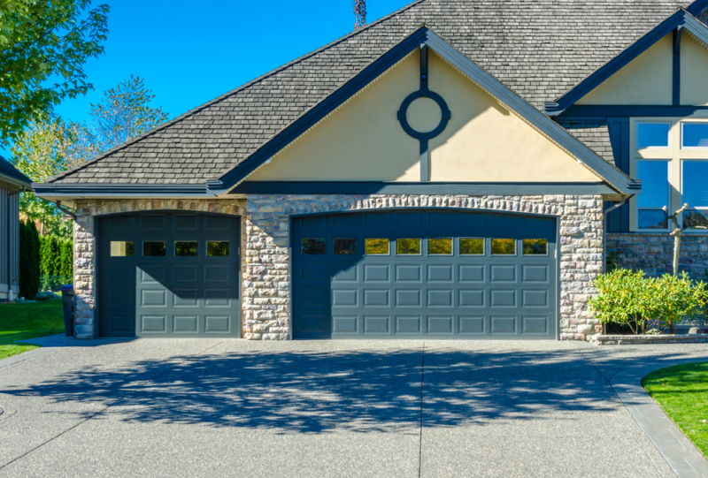 A house with a two door garage entry and wide driveway