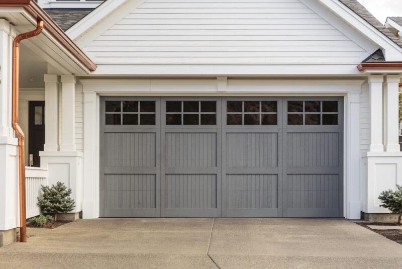 A gray, wooden garage door example of choosing a garage door
