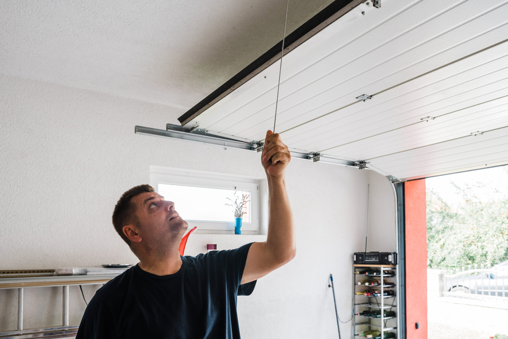 man learning about garage door safety