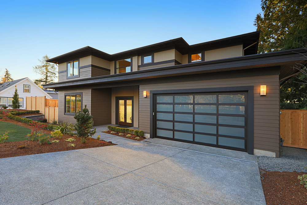 home with glass doors on the garage